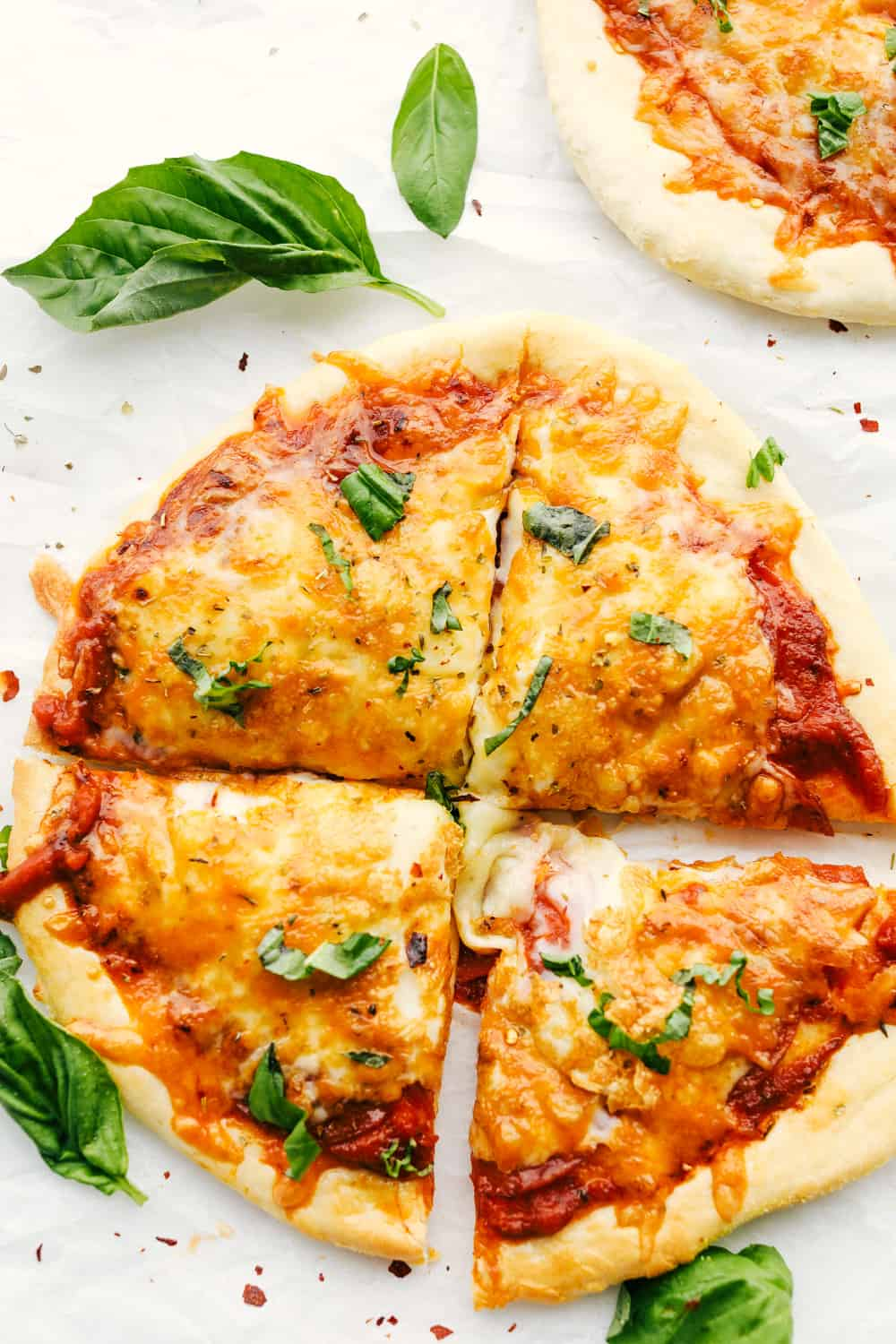 Sliced air fryer pizza, ready to eat.
