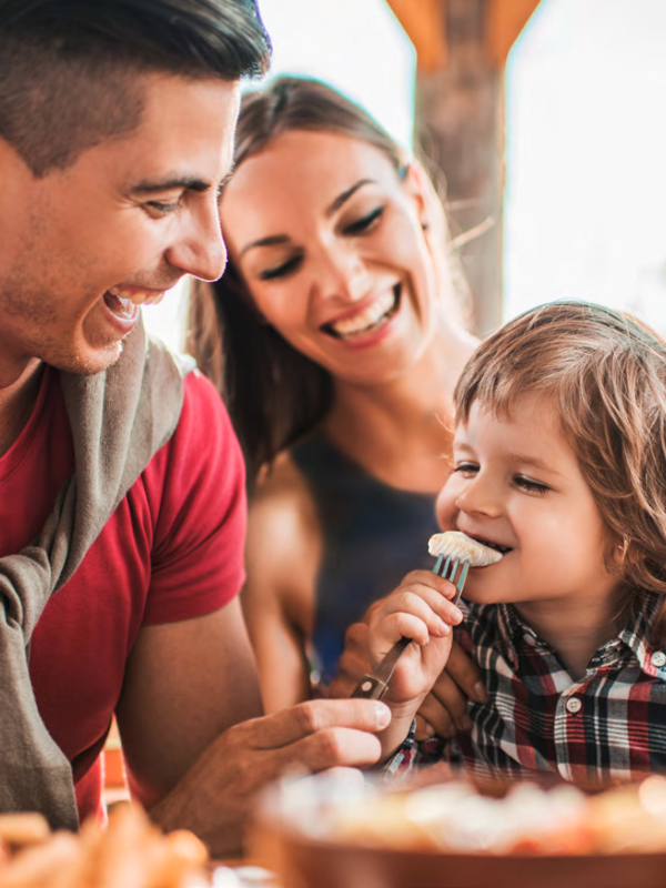 Family with child eating seafood