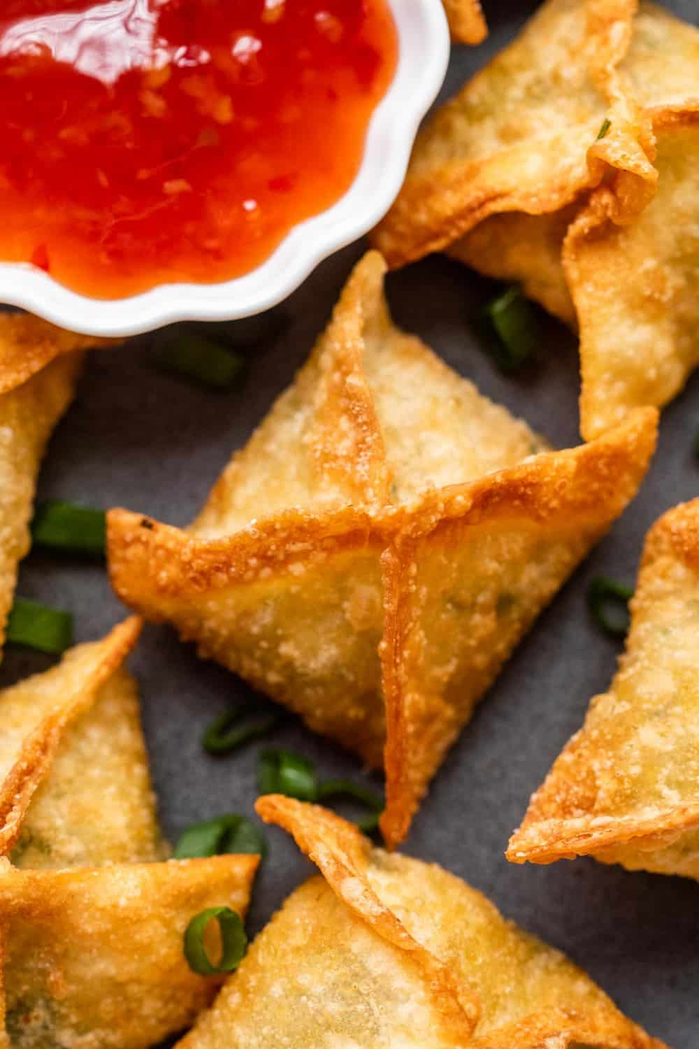 Closeup of a piece of crab rangoon on a plate