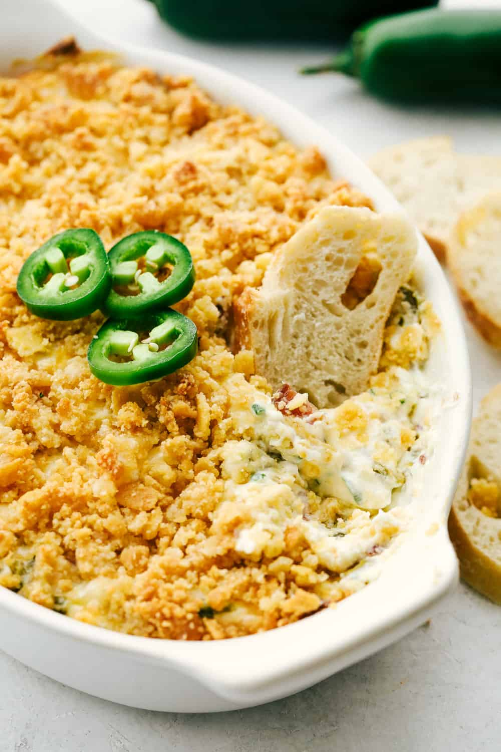 Creamy, spicy jalapeno dip with bread for dipping.