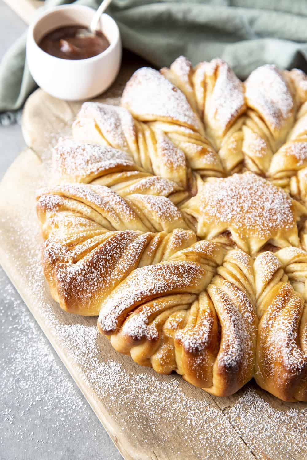Star bread on serving bread and dusted with powdered sugar.
