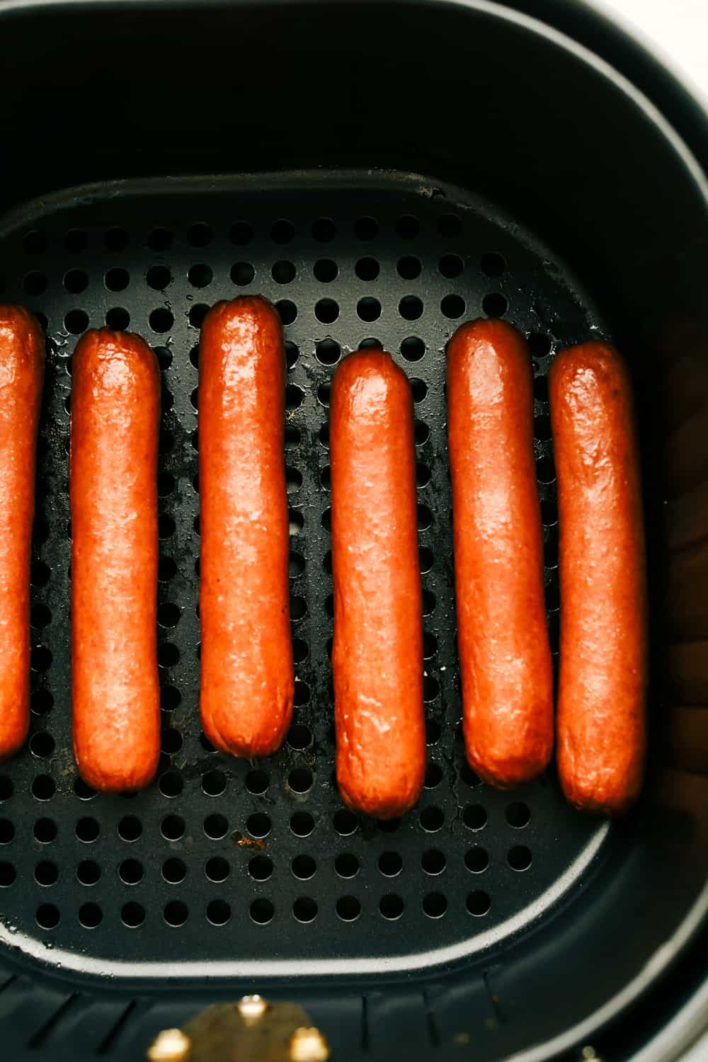 Up close picture of cooked hot dogs.