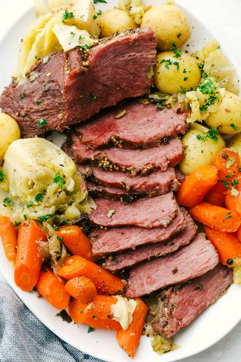 Corned beef, potatoes, cabbages, and carrots on a platter.