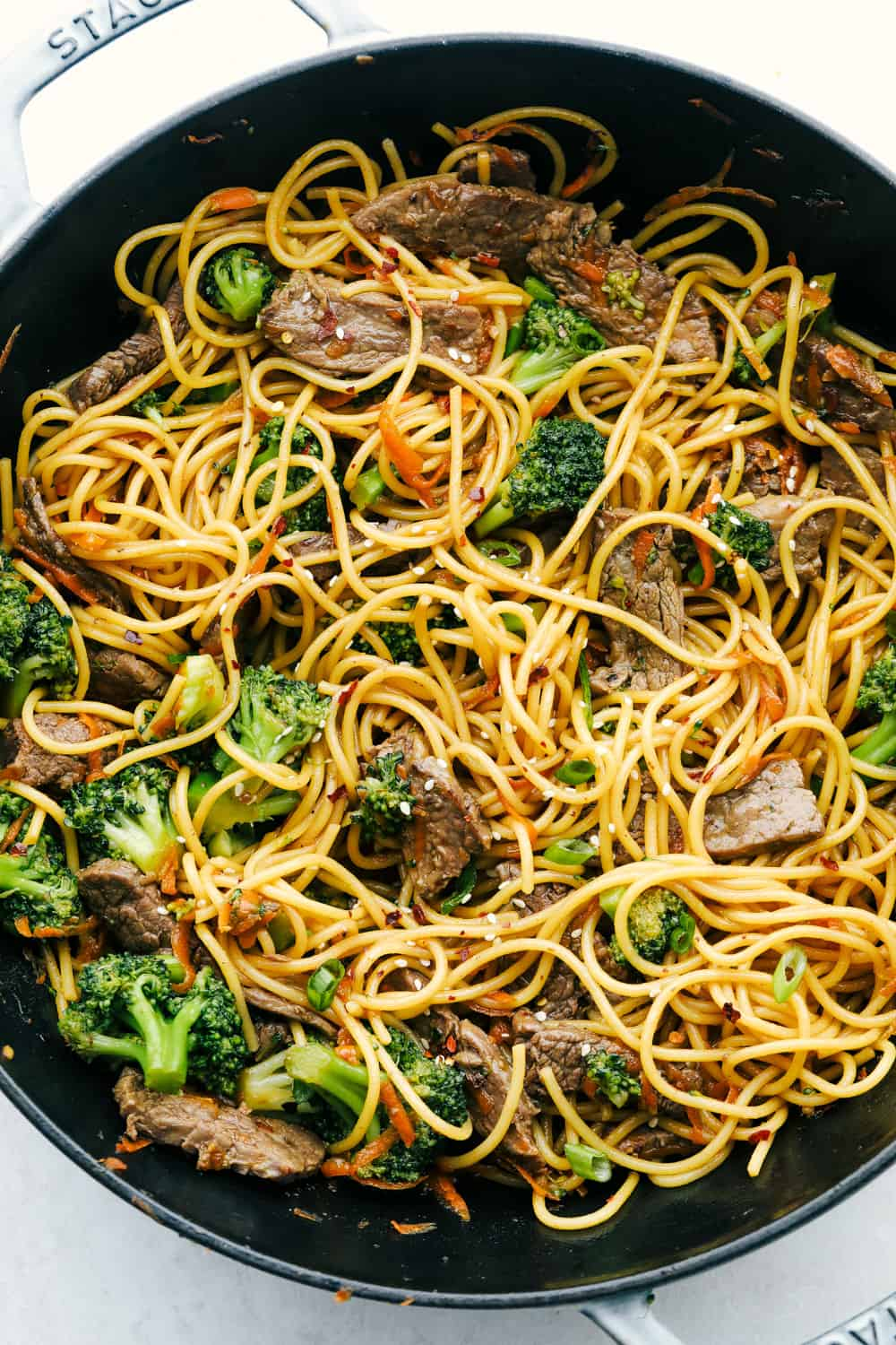 Beef and broccoli lo mein in a skillet.
