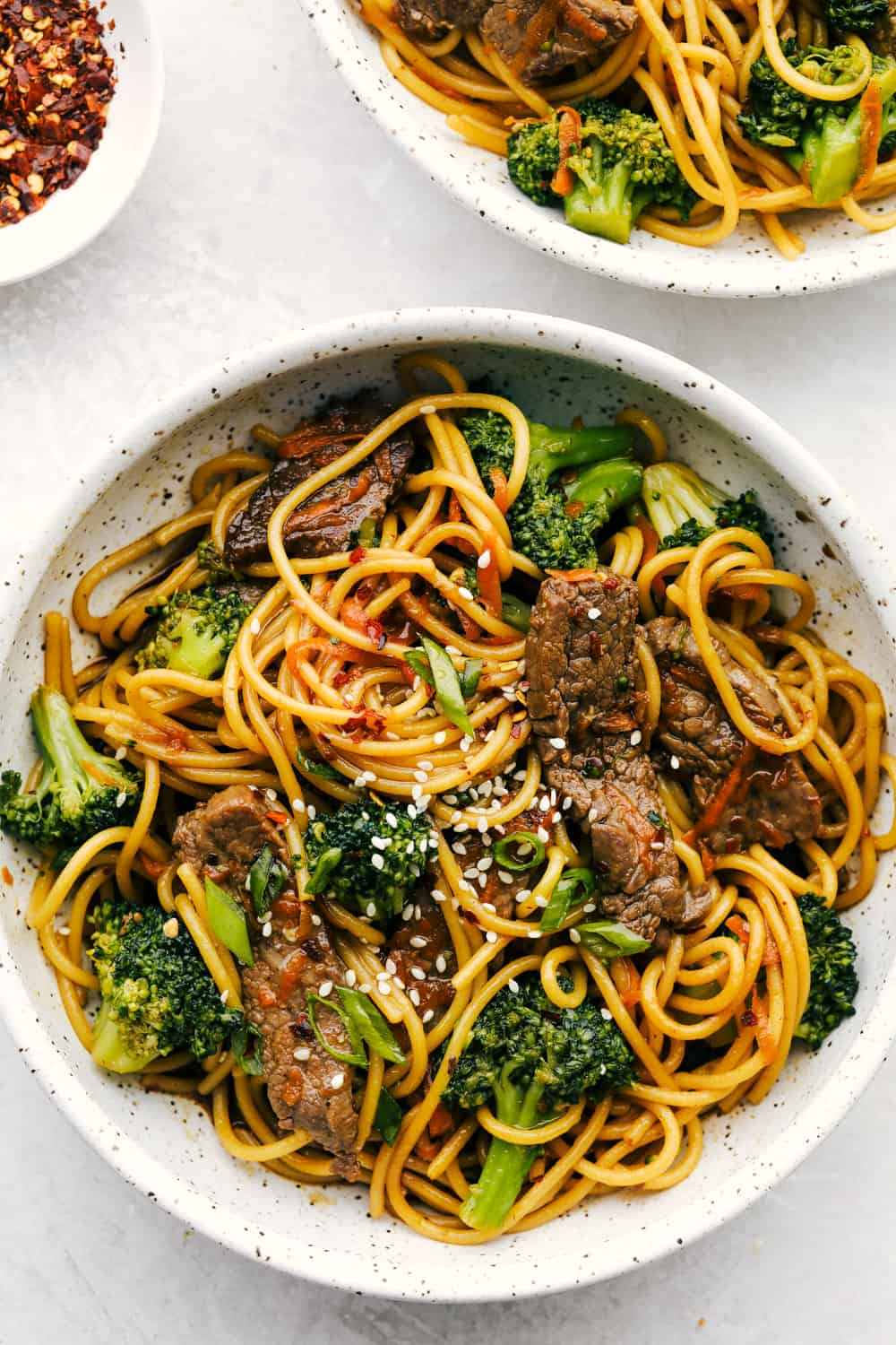 Beef and broccoli lo mein in a bowl.