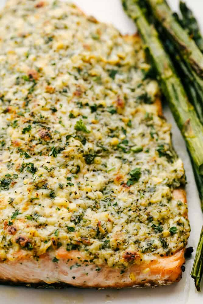 Salmon with parmesan and garlic on a platter.