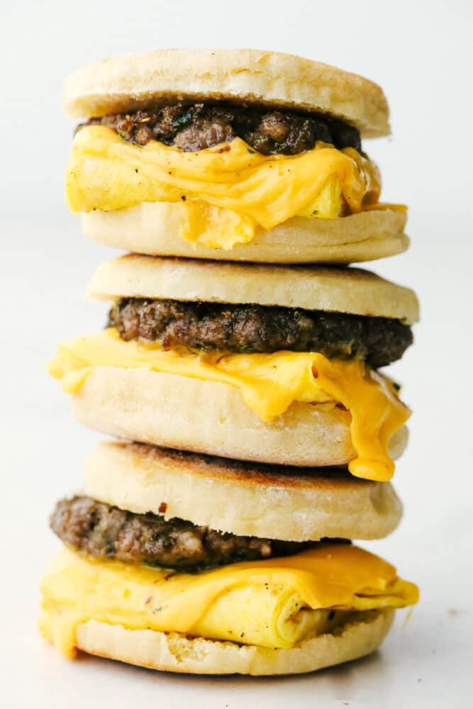 English muffin breakfast sandwiches stacked on top of each other.
