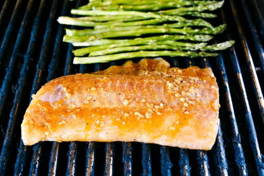 Cod and Asparagus on the grill cooking.