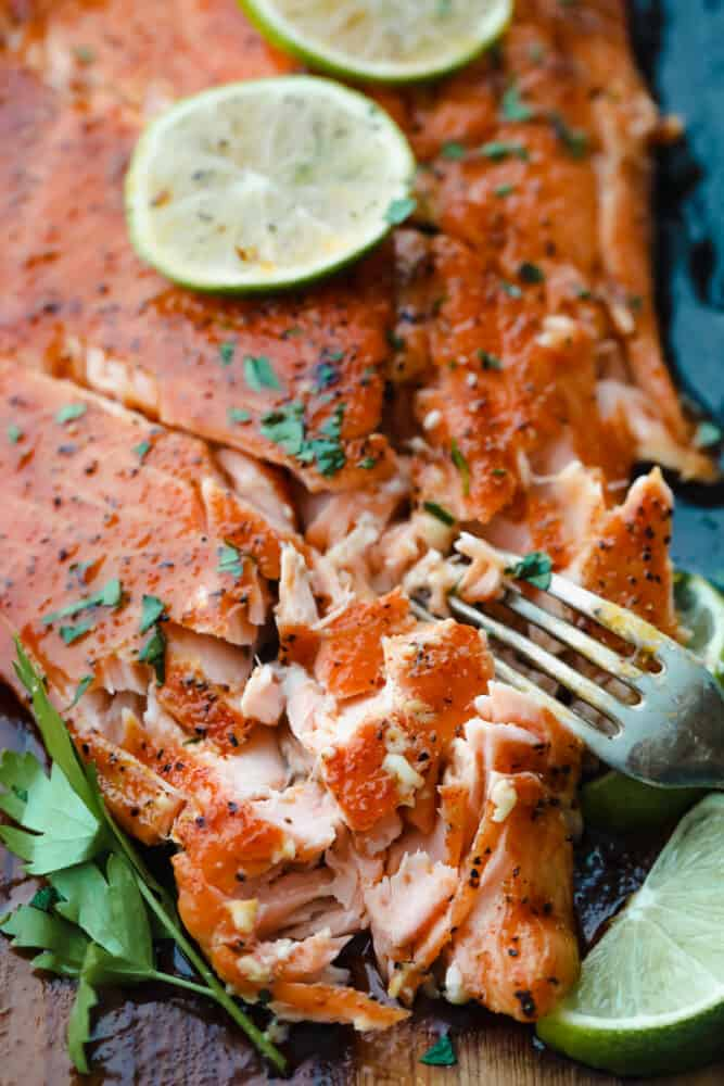 Salmon being cut with a fork.