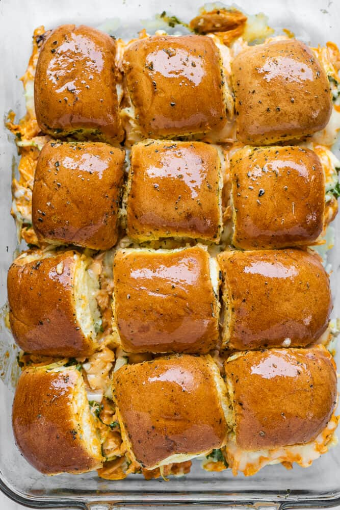 A pan of buffalo chicken sliders hot out of the oven.