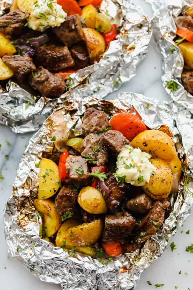 Steak and vegetables wrapped in foil.