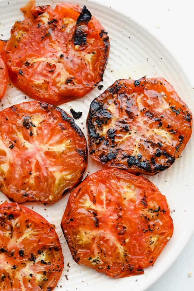Grilled tomatoes on plate