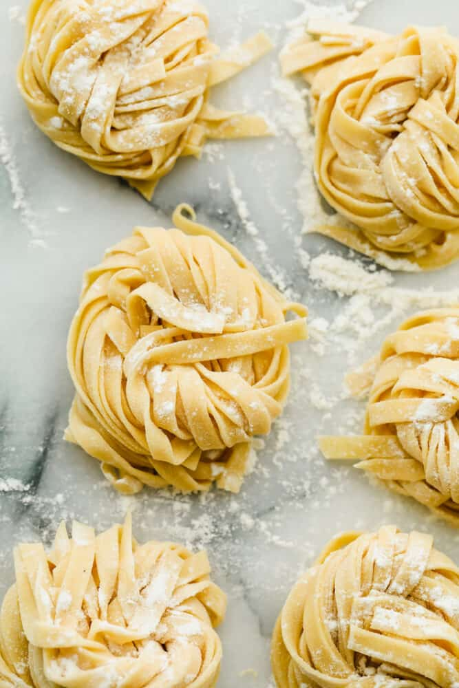 Homemade pasta in nests ready to cook.