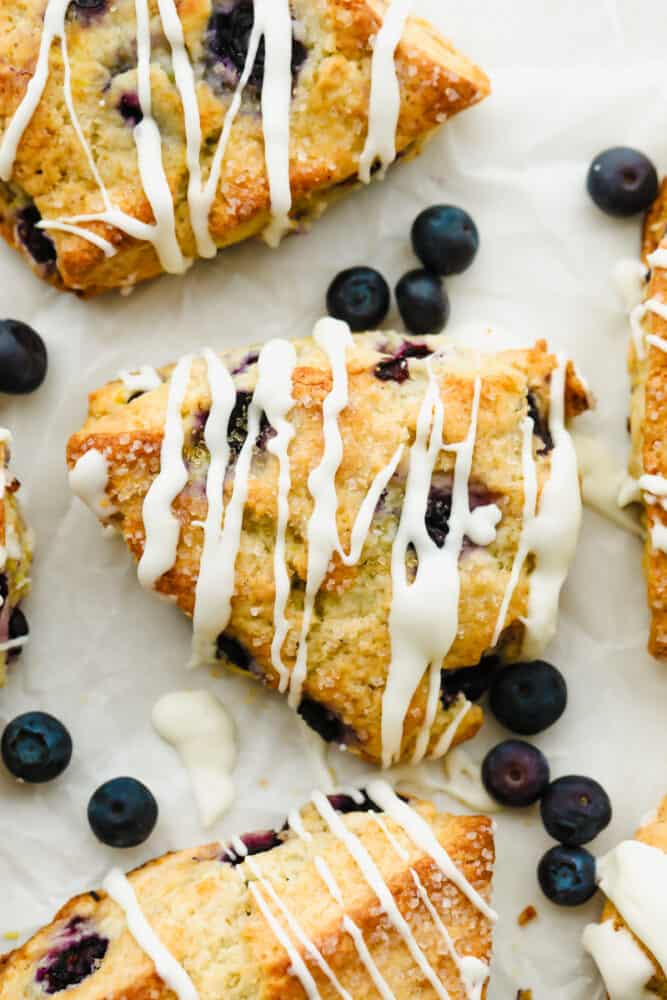 Blueberry Scones with icing drizzled on top.