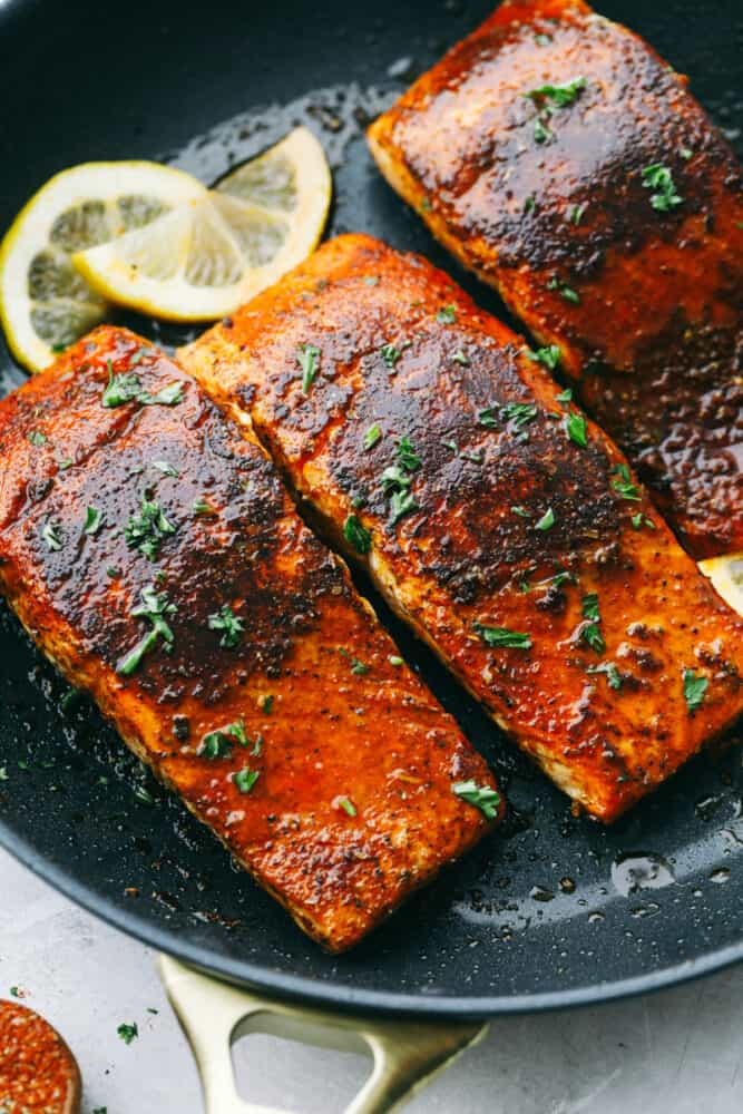 Blackened Salmon in a pan seared to perfection.