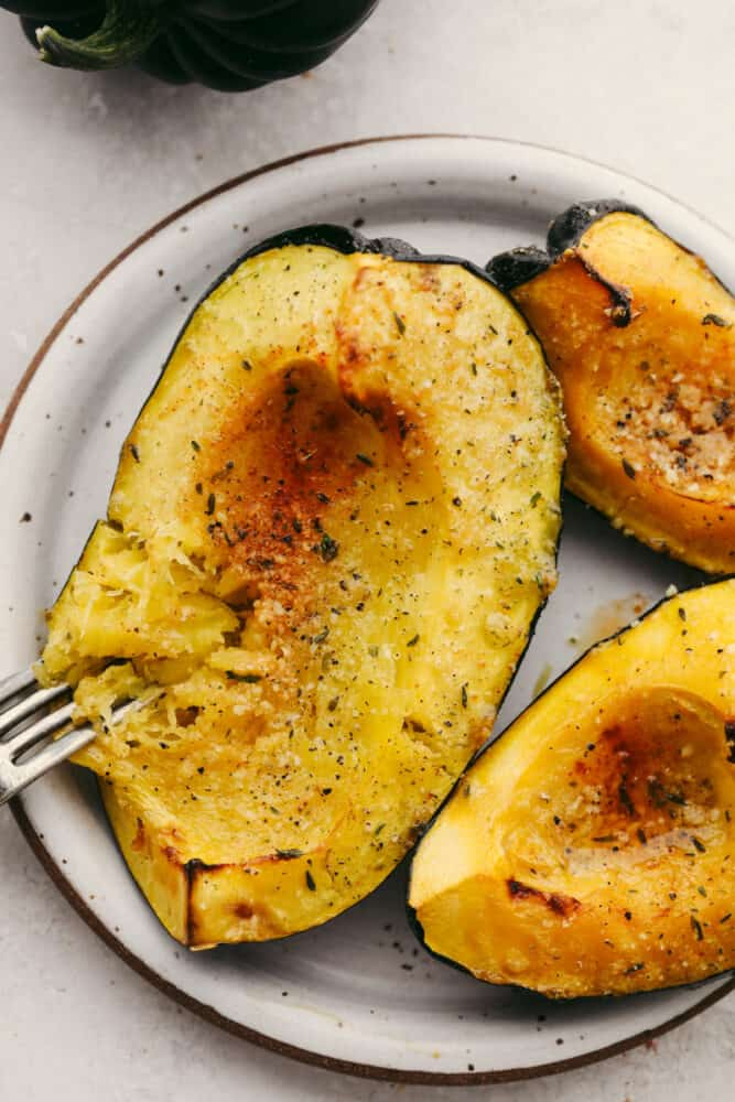 Roasted acorn squash with a fork.