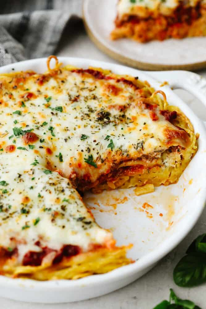 A spaghetti pie with a slice taken out of it.